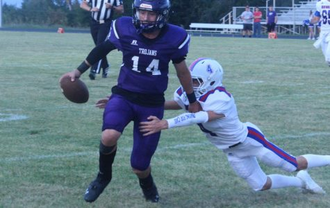 Quarterback Jaxson Gebhardt avoids a tackle from a Russell defender.