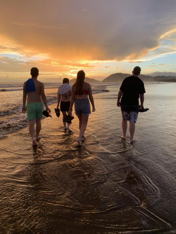 Braedon McVay, Leah Feldman, Bre Standley, and Cade Cooper walk on the beach at sunset. Jaco Beach is around a fourth of a mile away from the hotel the group was staying at.