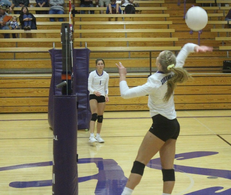 Katie Moddelmog jumps up to spike the ball at the game on Oct. 1.