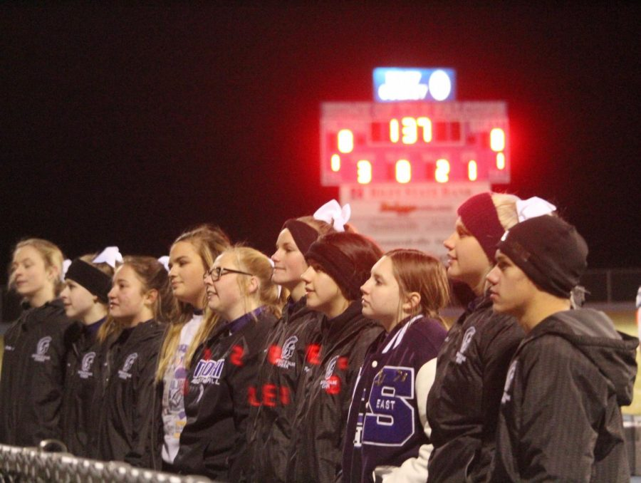 The SES Cheer Team gets ready to start a chant with the student section at the game on Friday.