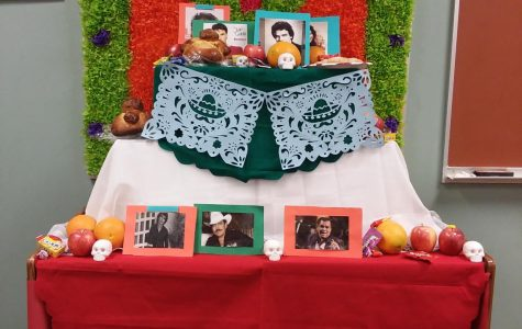 The Day of the Dead altar that Spanish Club members designed. It is decorated with tissue paper, photos of famous Central American singers, colored tablecloths, and many more.