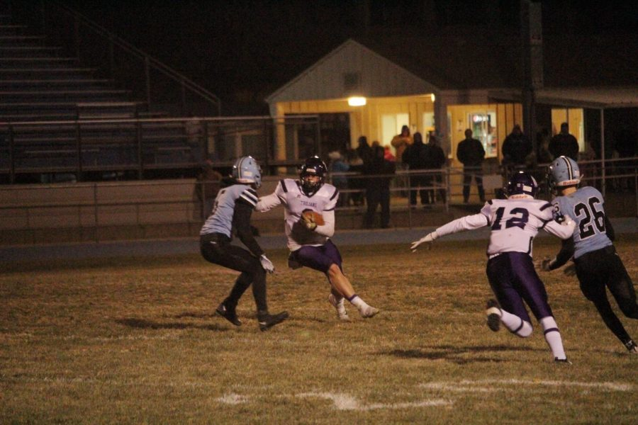Bryant Banks carries the ball and gains yards for the SES team.