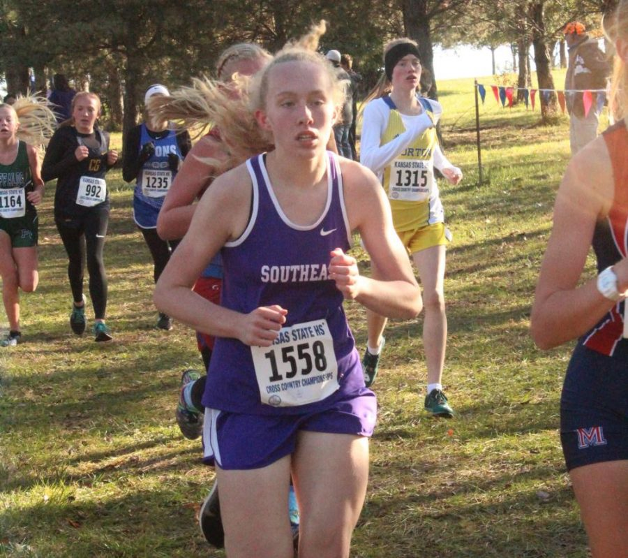 Mallorie Pearson works to keep up with the top runners to help lead her team to a state placing.