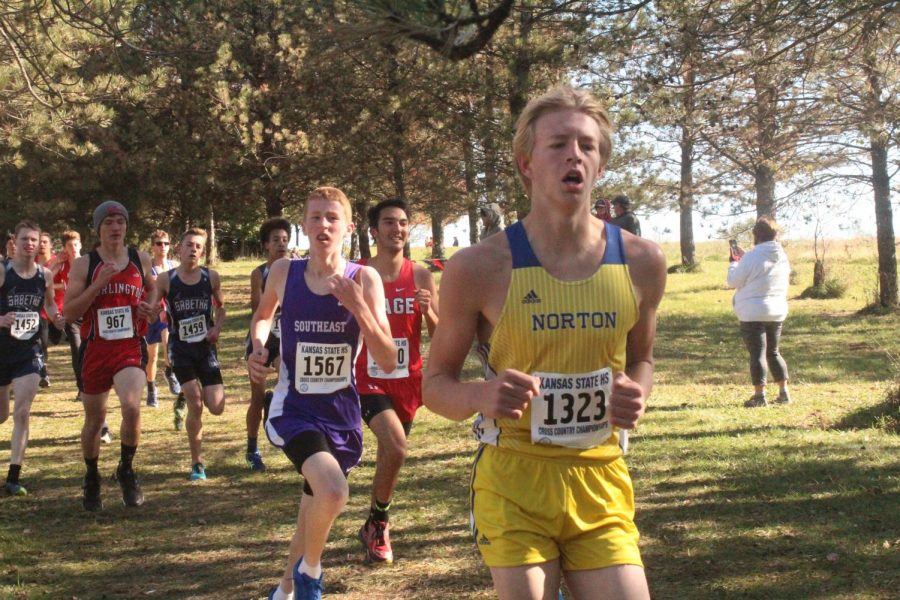 Joel Kejr fights to keep up with the pack at the state meet on Saturday.