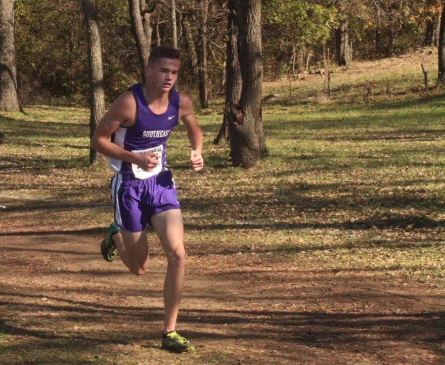 Dylan Sprecker races towards the end of the race and finishes with a time of 16:31.5. He claims first place at the state meet.