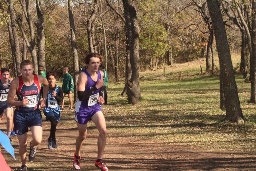 Drew Hanson fights up the hill towards the end of the race.