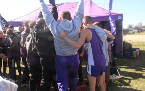 The team cheers in celebration when coach tells them the team results. The girls team received 2nd place and the boys team received 1st place.