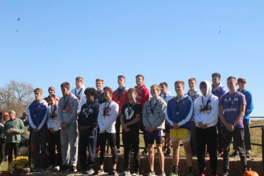 Dylan sprecker places 1st wtih a time of 16:31.5, Dominic Jackson places 4th with a time of 16:40.2, Luke Gleason places 5th with a time of 16:43.5, and Damien Jackson places 13th with a time of 17:12.4.