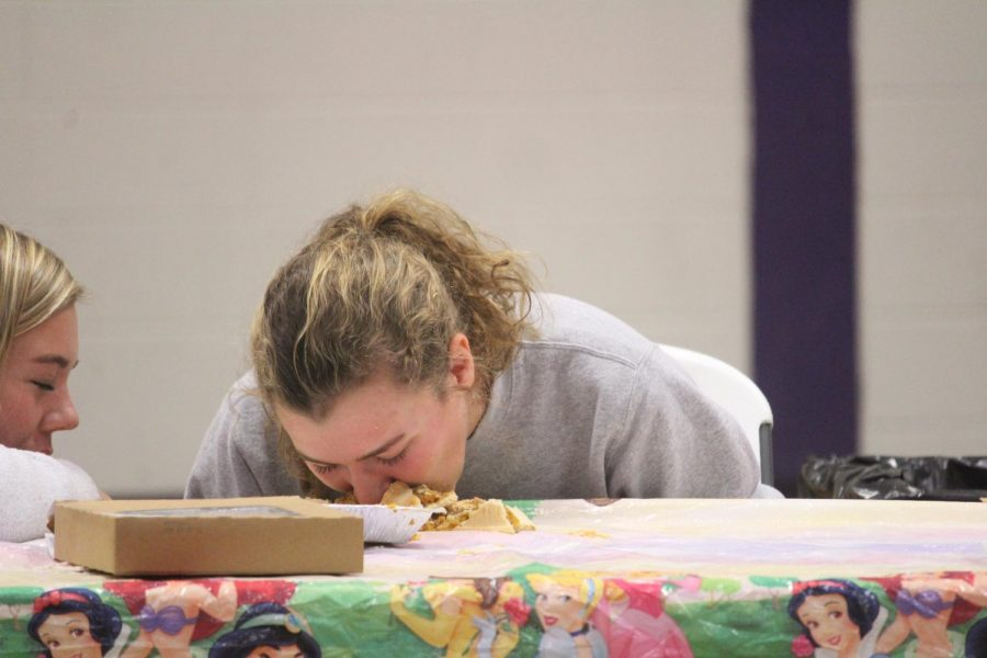 Madeline+Blake+competes+in+the+pie+eating+contest+against+two+other+students+and+a+teacher.