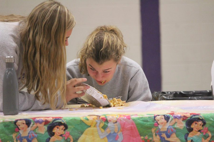 Kate Weis coaches Madeline Blake along during the pie eating contest. The contest was held as a fundraiser for Relay for Life.