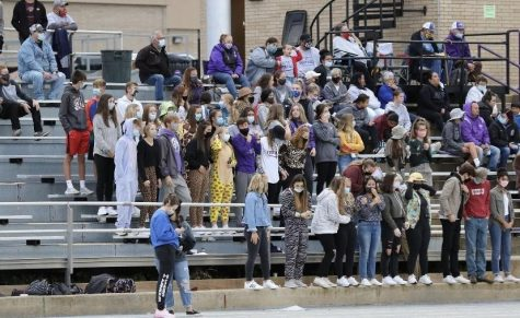 The SES student section at the football game cheered on the boys as they took the win against Beloit.