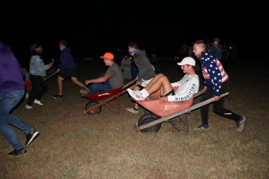 Caden Isaacson and Luke Gleason race head to head against Chase Poague and Karson Hall in the wheelbarrow races.