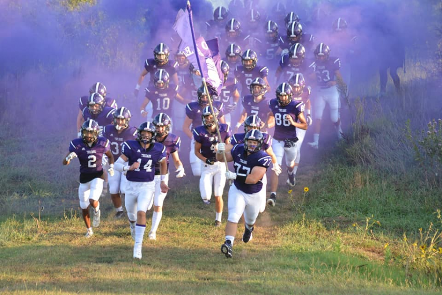SES football team make entrance for homecoming football game, being led by Jackson Gebhardt (#14) and Sterling Harp(#77)